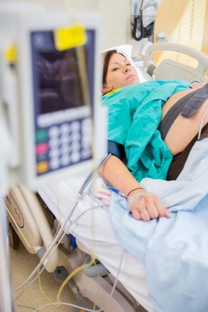 birthing: Detail of birthing woman with epidural