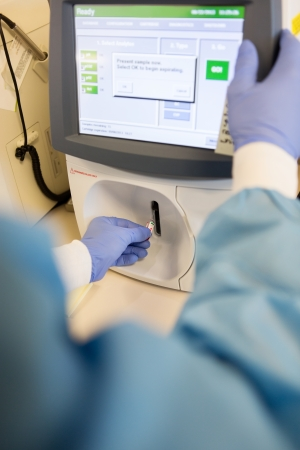 Cropped image of scientist performing blood gas analysis photo
