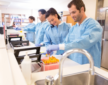 research facilities: Team of lab technicians preparing samples for referral in clinic Stock Photo