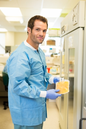 Medical lab tech with sample of frozen plasma photo