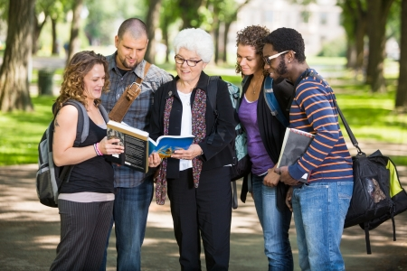 Group of senior students asking professor a question outdoors photo