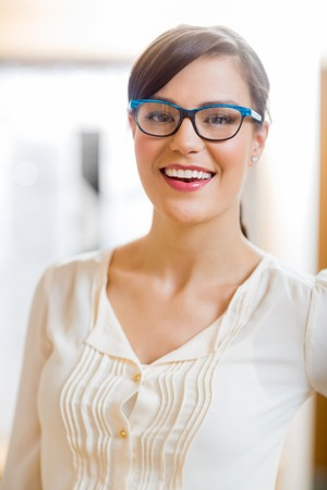 Portrait of beautiful woman wearing glasses in store photo