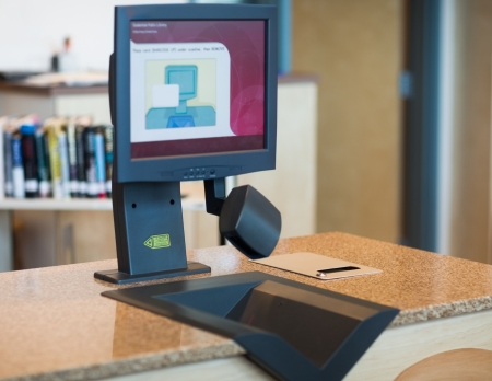 checkout: View of scanning machine at counter in library Stock Photo