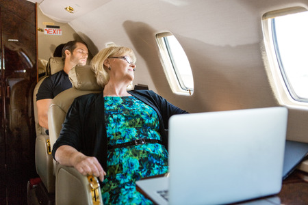 Business people sleeping on private plane Stock Photo