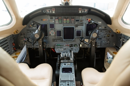 private jet: Instrument panels in cockpit of private business jet