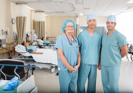 pacu: Portrait of multiethnic nurses standing in hospital ward