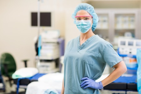 anesthetist: Portrait of young medical staff standing in operating theater Stock Photo