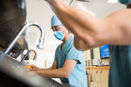Antibacterial: Male doctors washing hands before surgery in hospital