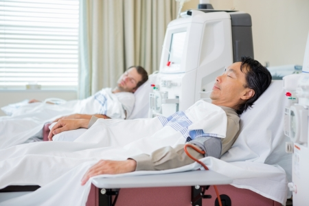Male patients receiving renal dialysis in hospital photo
