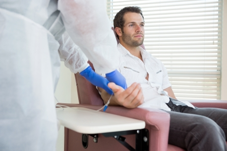 chemo: Young male patient receiving intravenous treatment in chemo room