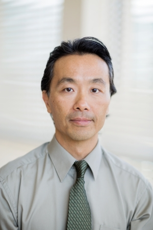 Portrait of confident Asian cancer specialist in shirt and tie at hospital photo