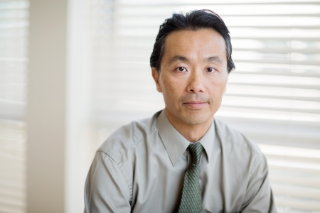 Portrait of confident male cancer specialist in shirt and tie at clinic photo