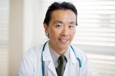 Portrait of Asian male cancer specialist with smiling in hospital photo
