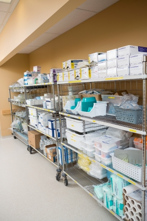 Large group of hospital supplies arranged on trollies in storage room Stock Photo