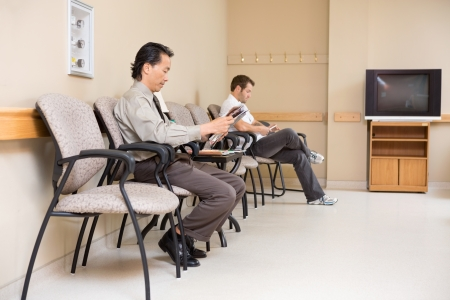 wait: Full length of male patients waiting in hospital lobby