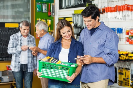 Happy Couple Buying Tools At Hardware Store photo