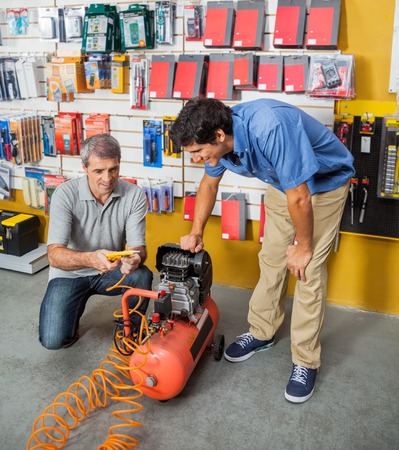 compressed: Family Examining Air Compressor In Store