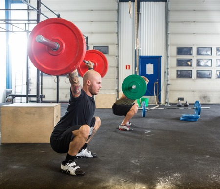 weightlifting equipment: Male Athletes in Cross Fitness Box