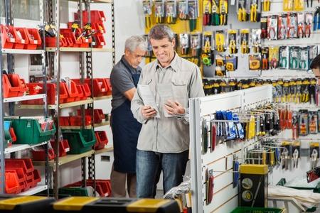 hardware store: Customer Choosing Soldering Iron In Store