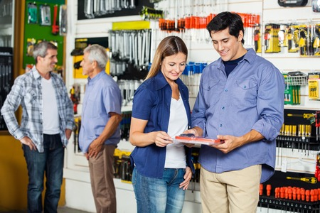 Couple Looking At Tool Set In Hardware Store photo