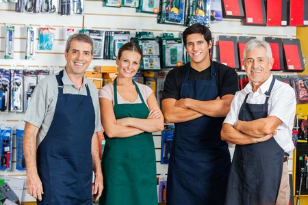business owner: Confident Salespeople In Hardware Shop Stock Photo