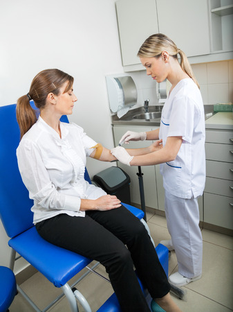 Businesswoman Undergoing Blood Test Stock Photo