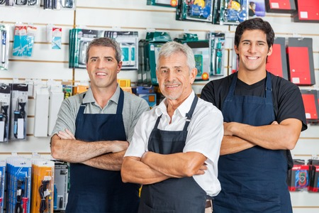business products: Confident Salesmen In Hardware Store Stock Photo
