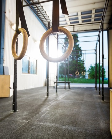 gymnastics equipment: Gymnastic Rings At Gym Stock Photo