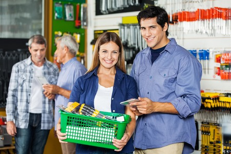Couple Buying Tools At Hardware Store photo