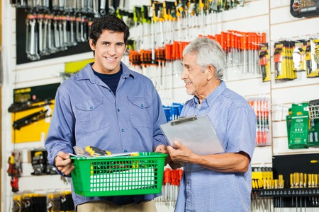 Father And Son Buying Tools In Hardware Store photo