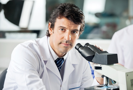 medical sample: Male Scientist Using Microscope In Lab