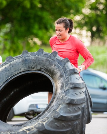 Determined Athlete Flipping Tractor Tire