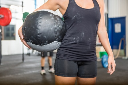Athlete Carrying Medicine Ball At Gym