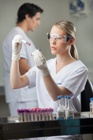 medical decisions: Technician Analyzing Blood Samples In Lab