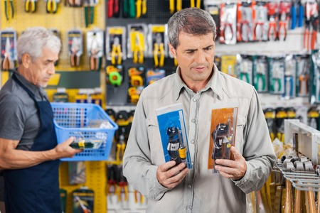 hardware: Customer Choosing Soldering Iron At Hardware Store