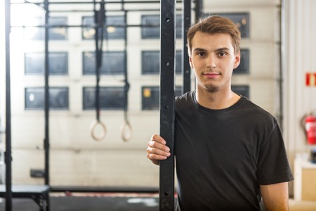 waistup: Confident Male Athlete Standing At Healthclub