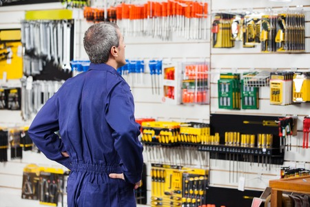 hardware: Worker With Hands On Hip In Hardware Store