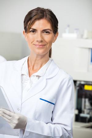 laboratory technician: Confident Female Scientist In Lab
