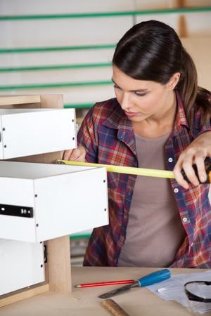 drawers: Carpenter Measuring Drawer With Measure Tape Stock Photo