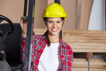 Female Architect In Hardhat By Forktruck photo