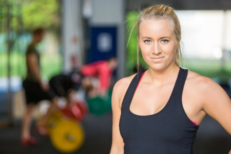 personal trainer woman: Beautiful Athlete Standing in Gym