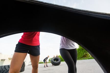 fit women: Fit Women Lifting Tire Outdoors
