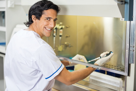 Happy Technician Experimenting In Laboratory