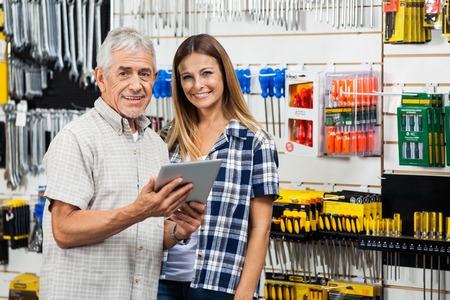 retailer: Woman And Father With Digital Tablet In Hardware Store