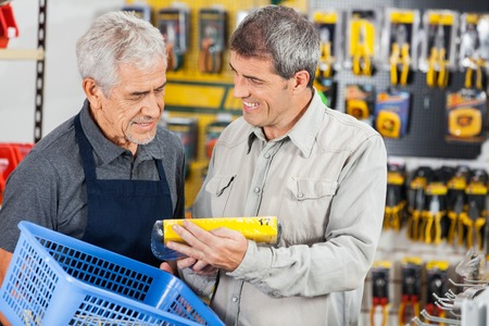 shopping questions: Salesman Assisting Customer In Buying Product