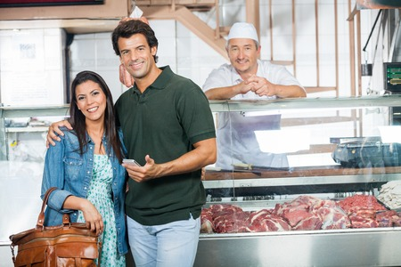 Couple Smiling In Butchery photo
