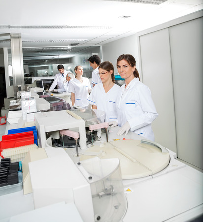 research facilities: Technician And Colleague Working In Laboratory Stock Photo