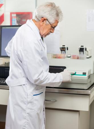 analyzer: Scientist Analyzing Samples Using Analyzer