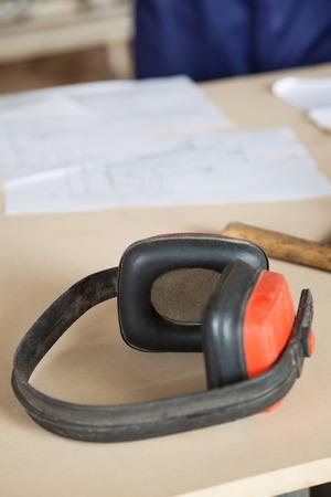protectors: Closeup Of Ear Protectors On Wooden Table