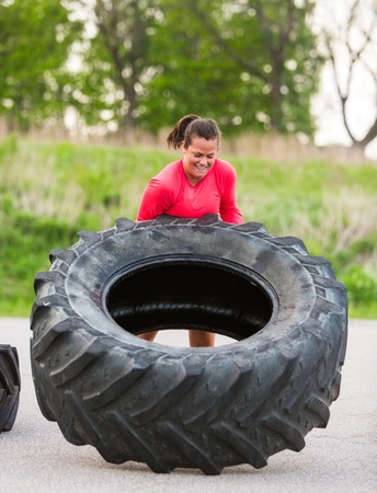 Athlete Flipping Truck Tire Outdoors